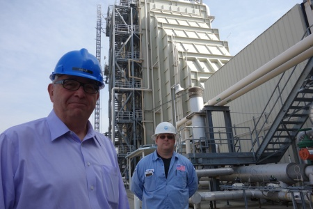 Fred Fletcher (left), former general manager of the Magnolia Power Project, stands with another worker at the natural gas-fired power plant in Burbank.