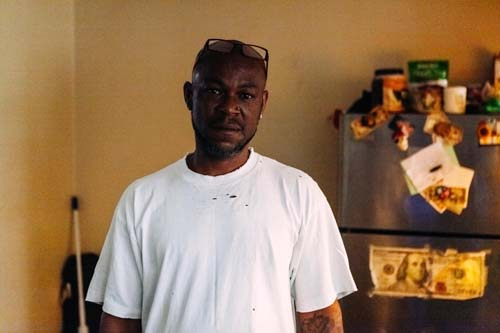 Vernon Moore stands in his kitchen at the River Glen Apartments.