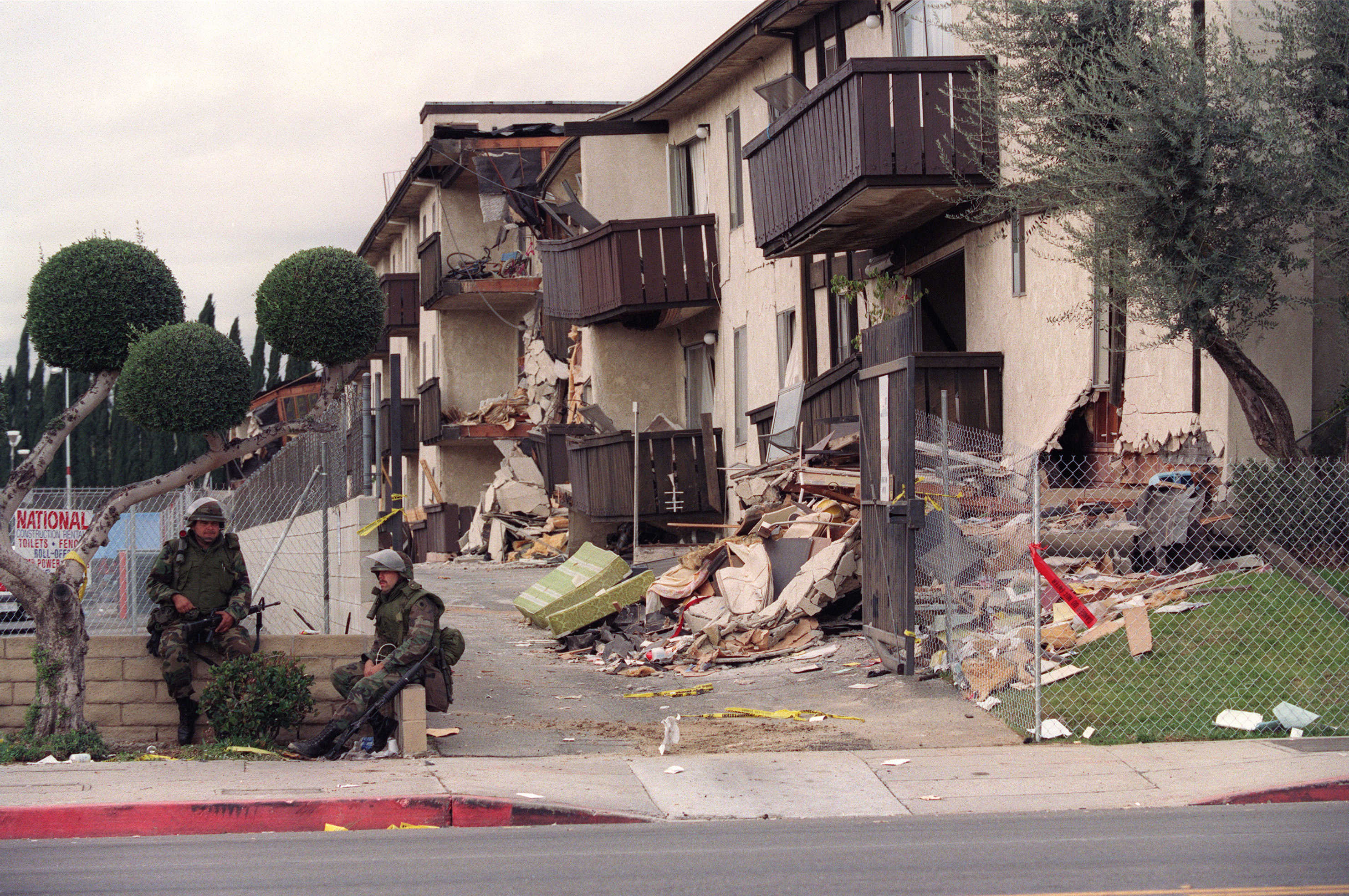 National Guard soldiers are posted in front of the Northridge Meadows apartments one week after 16 people died during an earthquake on Jan. 17, 1994. Residents were allowed to enter the condemned building for 15 minutes at a time to collect personel effects.
